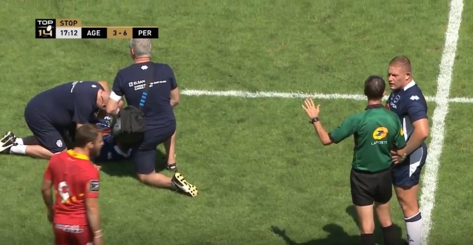 FOOTAGE: Ref waits patiently for injured player to get up before carding him