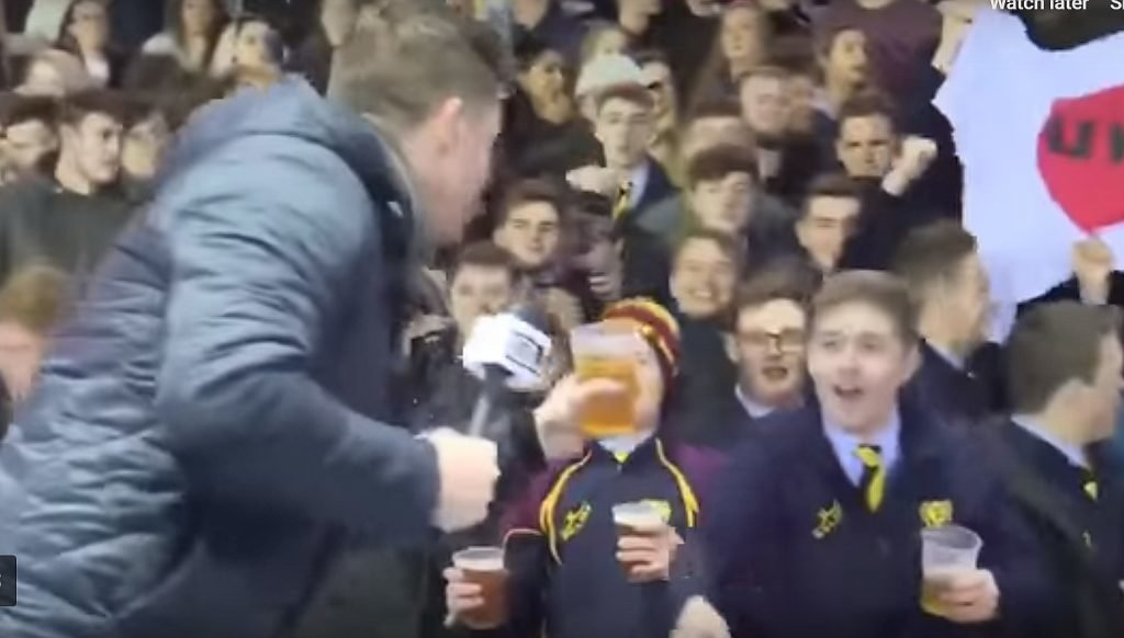 WATCH: A TV presenter is challenged by a rugby crowd, what he does next is broadcasting history
